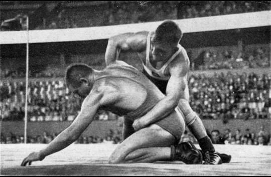 Wrestlers competing in a stadium at the 1936 Summer Olympics.