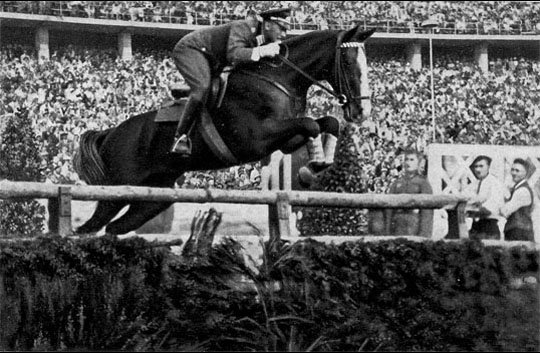 An equestrian rider competing in show jumping at the 1936 Summer Olympics.