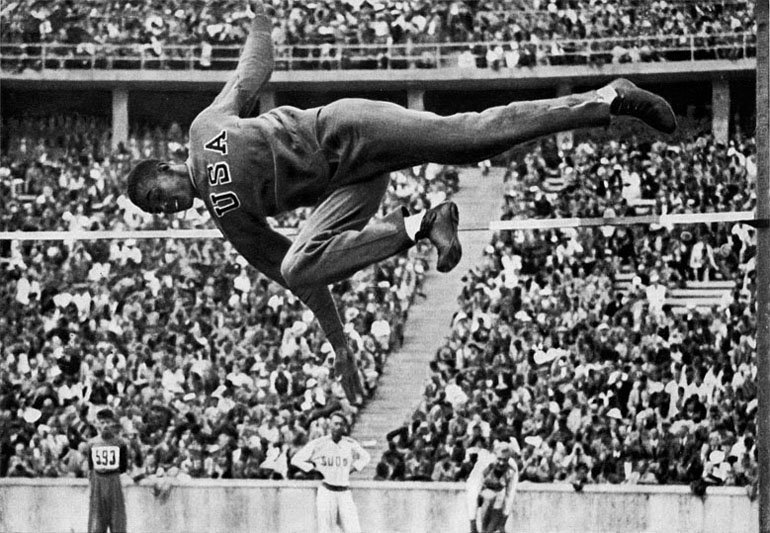 A United States high jumper competing in a stadium, at the 1936 Summer Olympics.