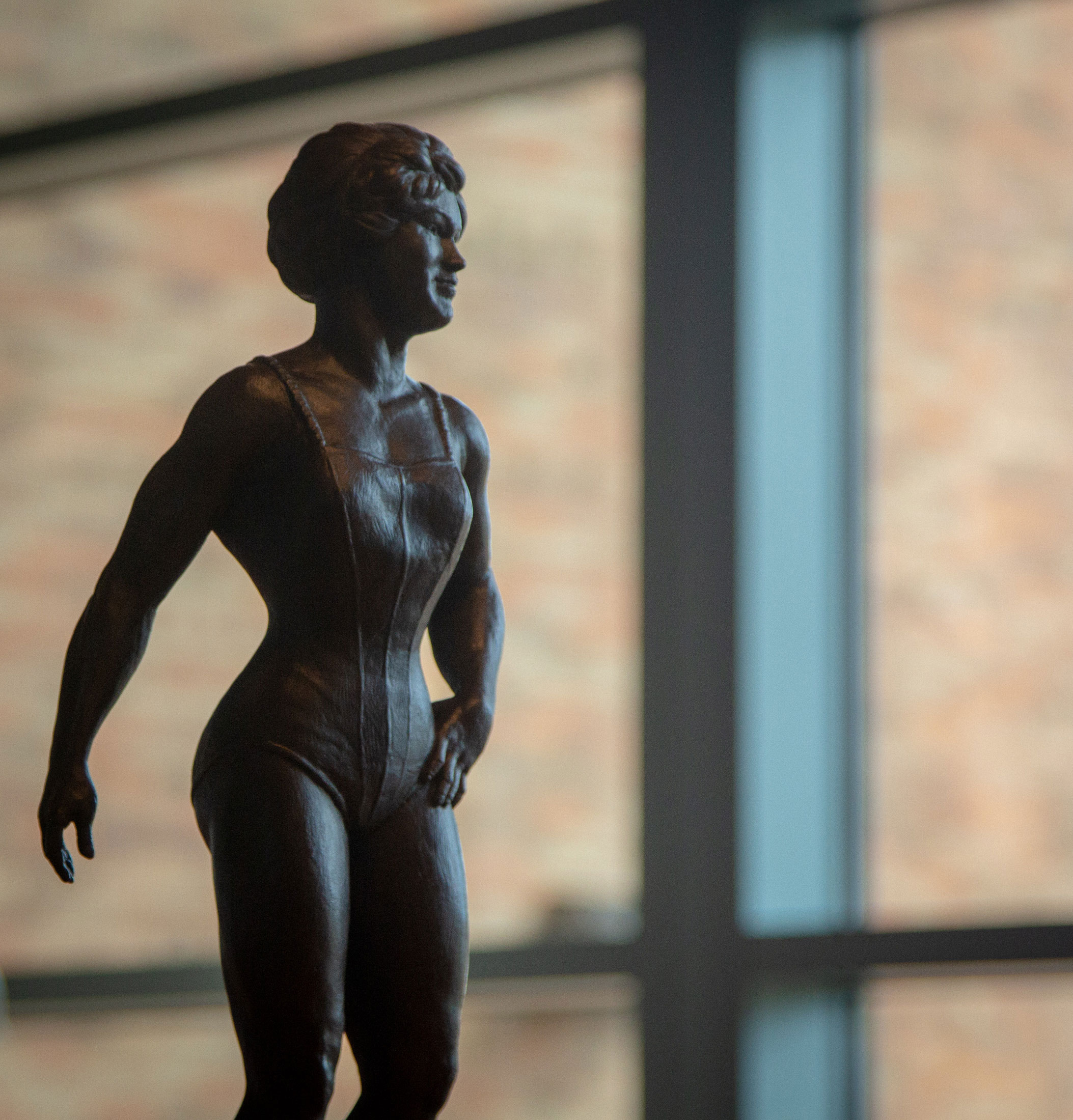 Bronze sculpture of strongwoman Katie Sandwina, by David Deming, from the David Deming Sculpture Collection, in the Reading Room.