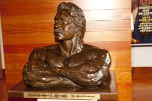 Bust of publisher Joe Weider: The Trainer of Champions, in a front double triceps pose, from the Weider Art Collection, in the Reading Room.