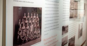 A panel illustrating the story of H.J. Lutcher Stark, Clyde Littlefield, and the undefeated 1914 Texas Longhorn football team, in the 1914: A Perfect Season Gallery.