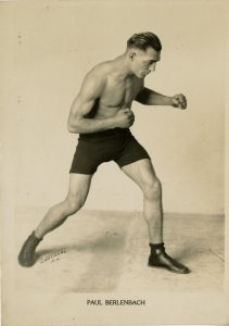 Boxer Paul Berlenbach, in a boxing pose, likely from the Albert Davis Boxing and Sport Photography Collection.