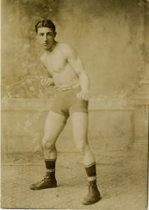 An uknown young man in boxing attire.