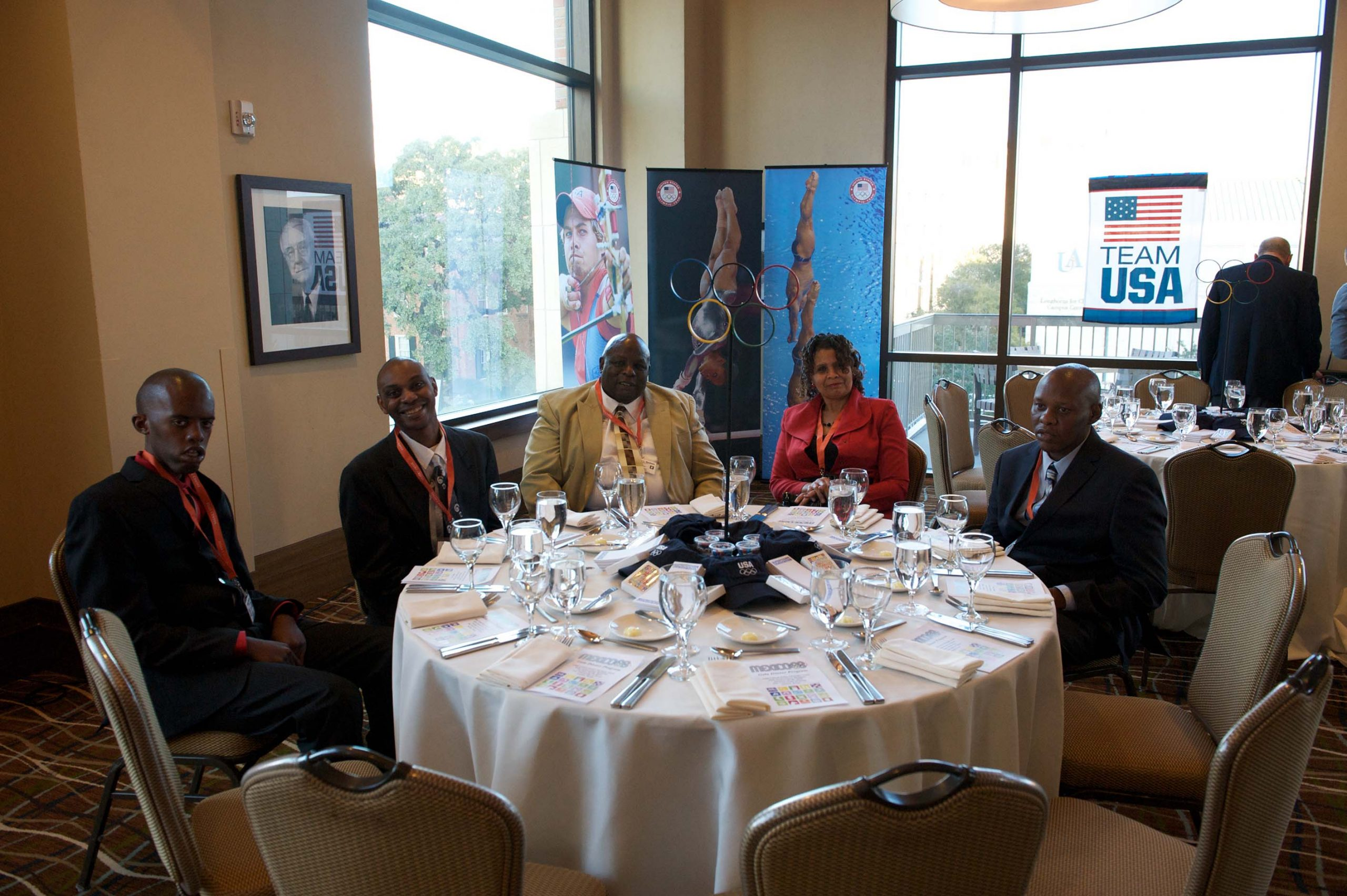 Five people at a table at the 1968 U.S. Olympic Team 2012 Reunion.