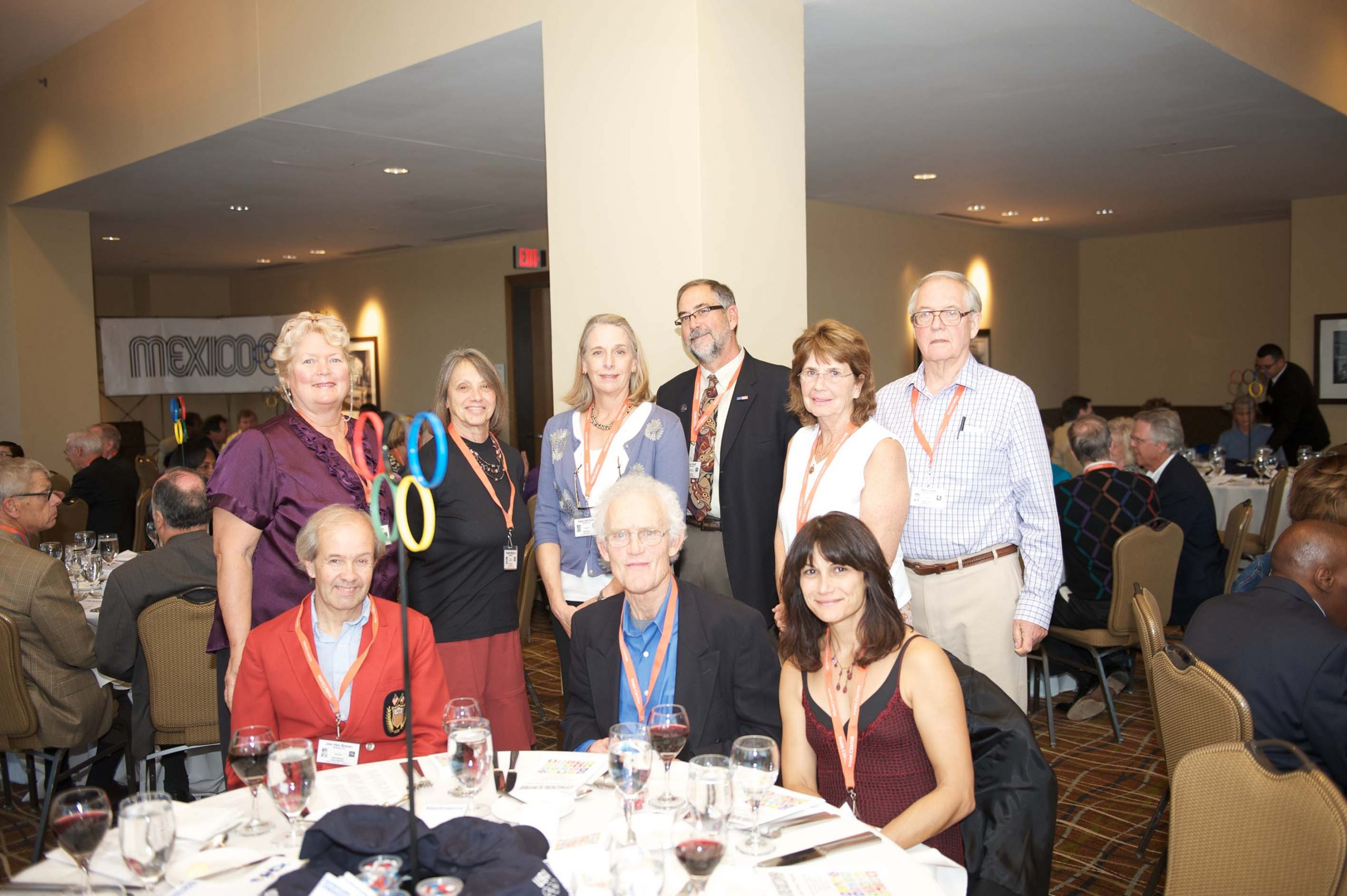 Nine people at a table at the 1968 U.S. Olympic Team 2012 Reunion.