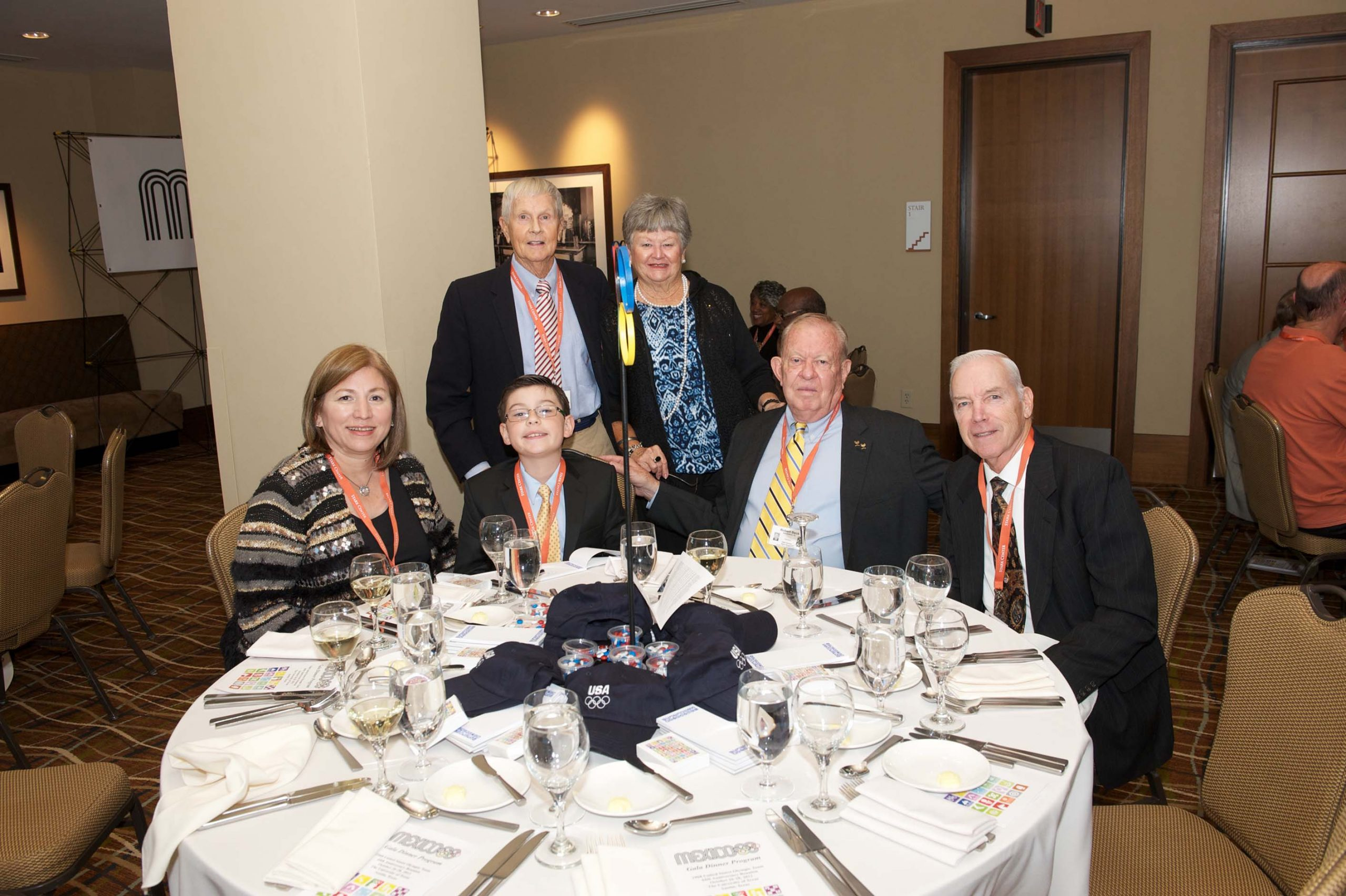 Six people at a table at the 1968 U.S. Olympic Team 2012 Reunion.