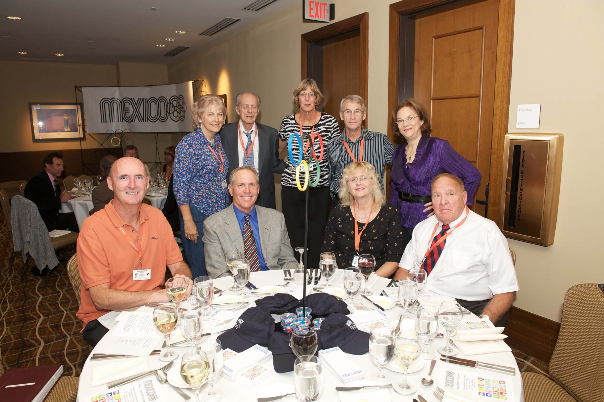 Thirteen people at two tables at the 1968 U.S. Olympic Team 2012 Reunion.