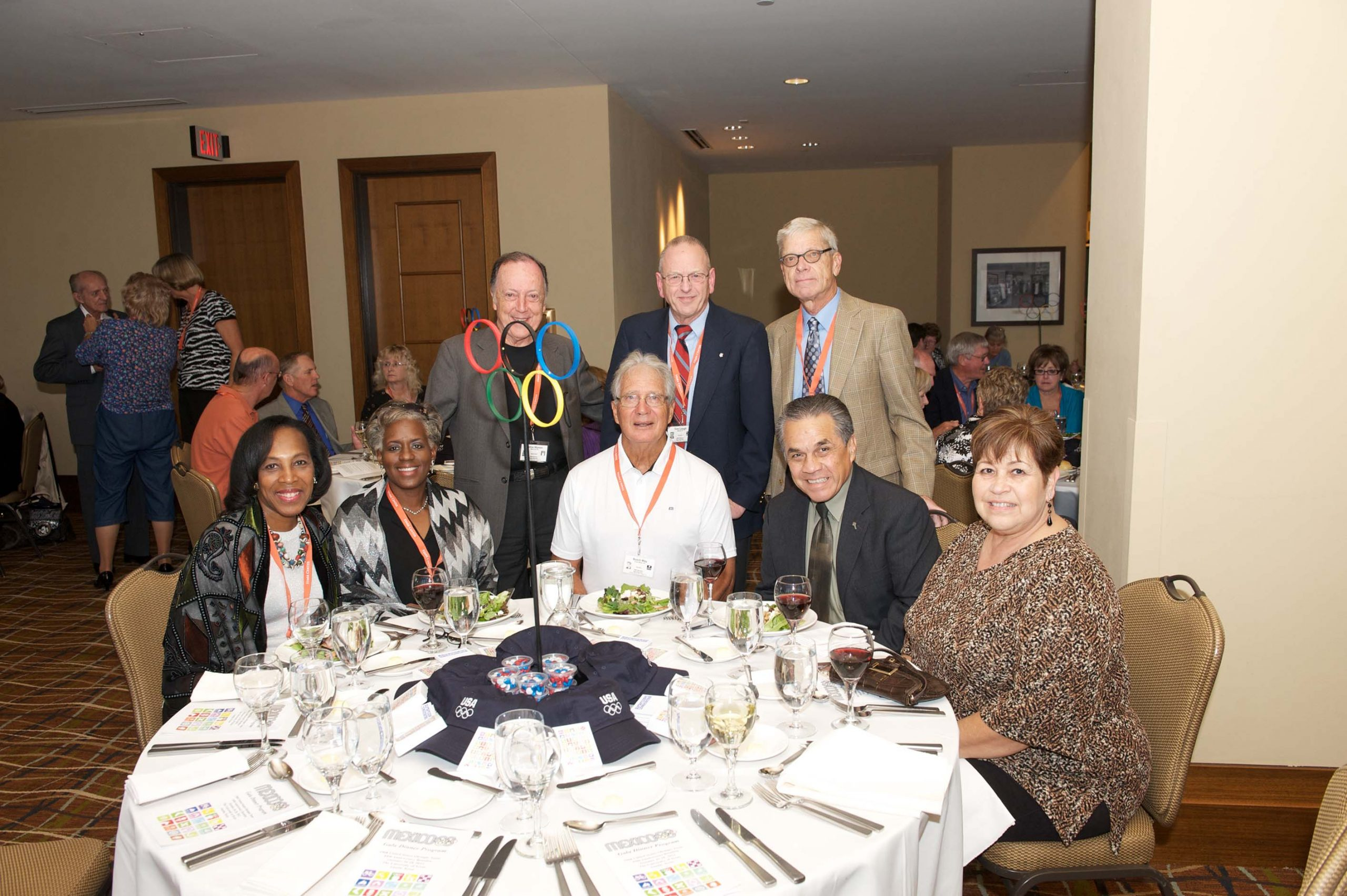 Fourteen people at three tables at the 1968 U.S. Olympic Team 2012 Reunion.