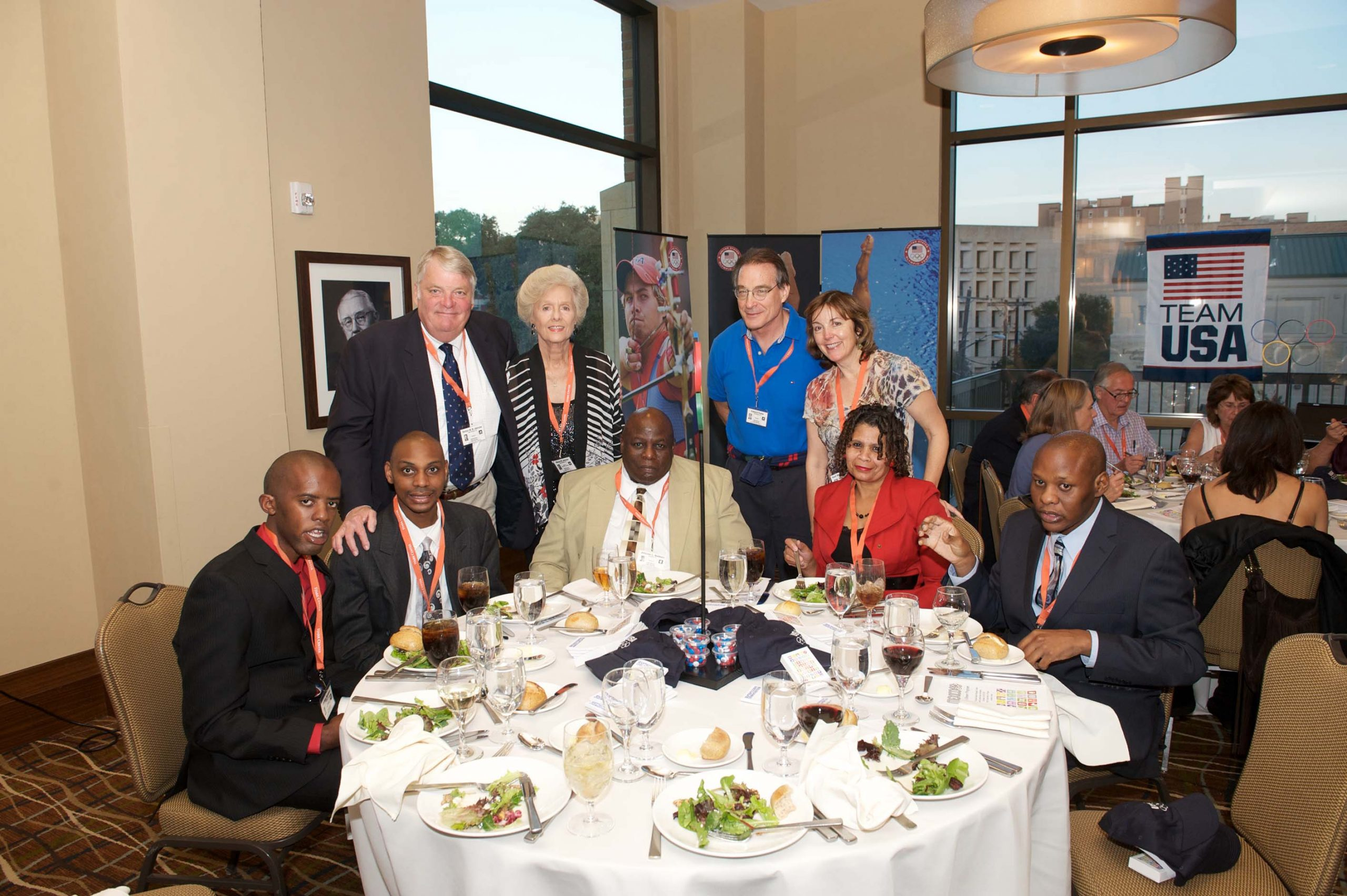 Fifteen people at two tables at the 1968 U.S. Olympic Team 2012 Reunion.