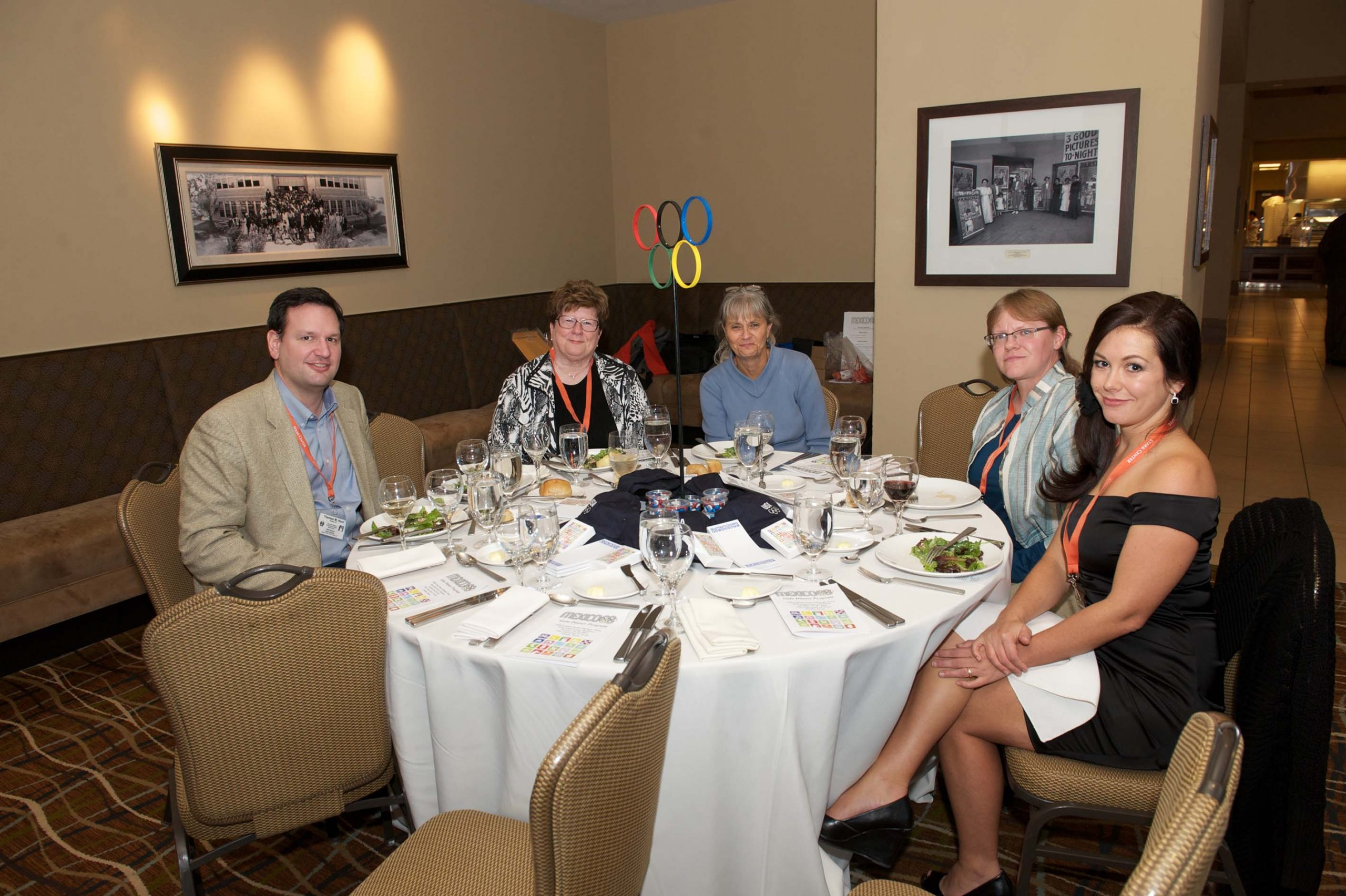 Thomas M. Hunt, a woman, Cindy Slater, Kim Beckwith, and Desiree Harguess, at a table at the 1968 U.S. Olympic Team 2012 Reunion.