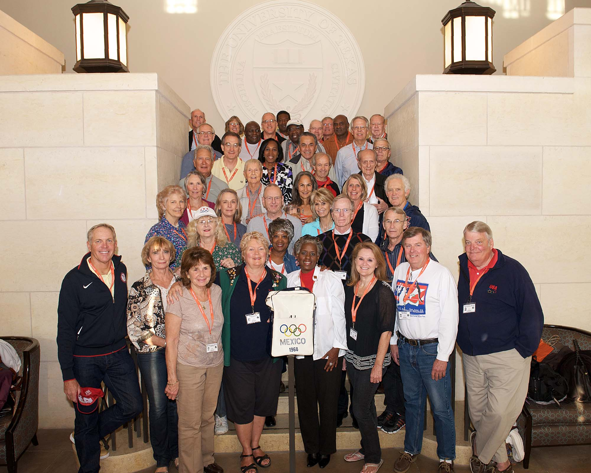 Thirty-eight people posing for a picture on some stairs, during the 1968 U.S. Olympic Team 2012 Reunion.