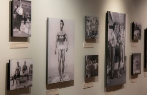 Eight photographs, including ones of bodybuilder Steve Reeves and of publisher Joe Weider and bodybuilder Arnold Schwarzenegger, in the Joe and Betty Weider Museum of Physical Culture.