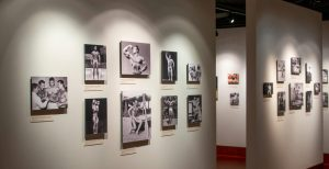 Seventeen photographs of bodybuilders, in The Joe and Betty Weider Museum of Physical Culture.