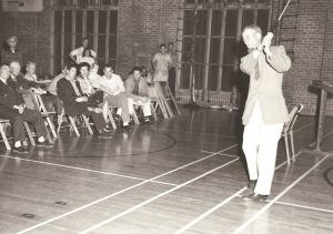 Former University of Texas golf coach Harvey Penick giving a swing demonstration, from the Harvey Penick and Tinsley Penick Golf Collection.