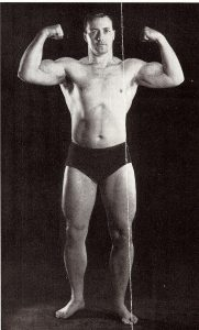 Young Bob Hoffman, of York Barbell Company and Strength and Health magazine, doing a front double biceps pose, from the Bob Hoffman and Alda Ketterman Collection.