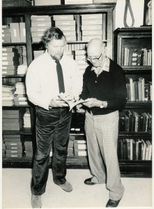 Stark Center co-founder Terry Todd and Roy J. McLean, in front of the materials and books of the Todd-McLean Collection, in Gregory Gym at the University of Texas at Austin.