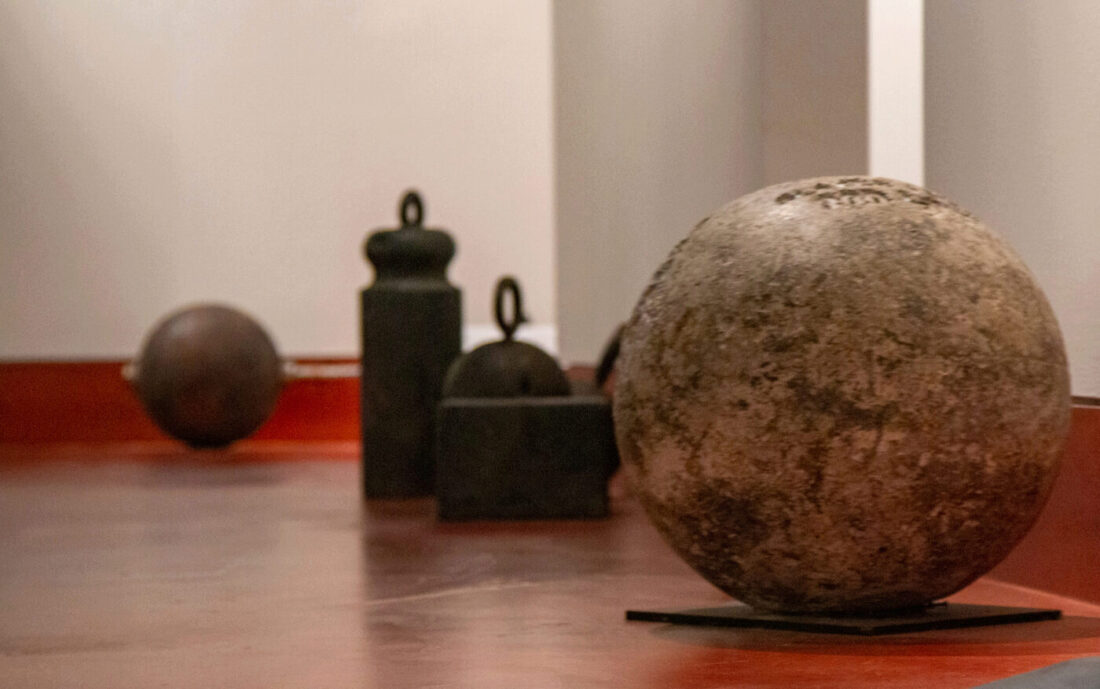 Barbells, kettlebells and other weights in the main lobby.