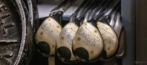 Four Ping golf clubs: a driver and 2, 3 and 4 woods, in the closed stacks room.