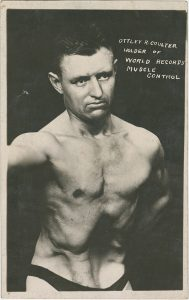 Strongman Ottley Coulter demonstrating his abdominal muscle control techniques, captioned: Ottley R. Coulter: Holder of World Records Muscle Control, from the Ottley Coulter Collection.