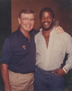 Former University of Texas football coach Darrell K. Royal and former Texas football player Earl Campbell in 1982, from the scrapbooks in the Darrell K. Royal Collection.