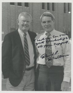 Autographed photograph of former University of Texas football coach Darrell K. Royal, with former Texas football player and coach David McWilliams, from the scrapbooks in the Darrell K. Royal Collection.