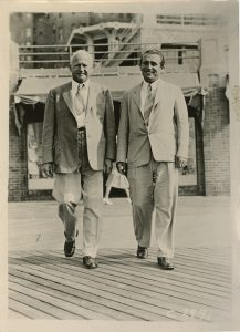 Anti-smoking campaigner Jesse Mercer Gehman and another man walking, from the Jesse Mercer Gehman Collection.