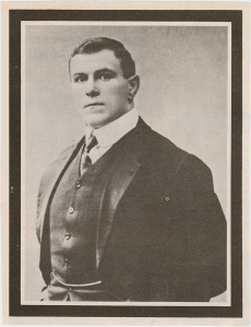 Wrestler and strongman George Hackenschmidt in a suit, from the George Hackenschmidt Collection.