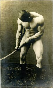 Wrestler and strongman George Hackenschmidt pulling on a rope from the George Hackenschmidt Collection.