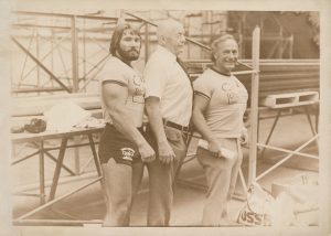 Bob Hoffman, of York Barbell Company and Strength and Health magazine, with two weightlifters, from the Bob Hoffman and Alda Ketterman Collection.