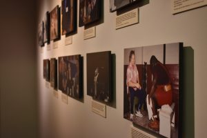 Eleven photographs of Stark Center co-founder Terry Todd, including one of Todd with wrestler and strongman Mark Henry, in the He Liked Big Things Gallery, in the main lobby.