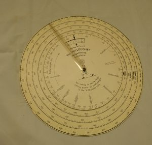 Bodybuilder David P. Willoughby's wheel shaped Weightlifting Calculator, from the David P. Willoughby Collection.