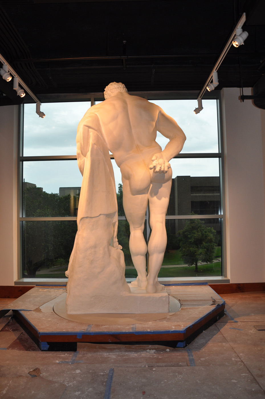 Back view of the statue of the Farnese Hercules being installed, in the main lobby, in 2009