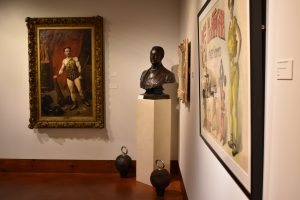 One corner of the Teresa Lozano Long Art Gallery featuring a bust of Eugen Sandow by Frederick Pomeroy, from the Weider Art Collection; and the Professor Louis Attila (Ludwig Durlacher) oil painting, from the Todd Art Collection.