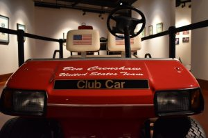 The golf cart driven by 1999 United States Ryder Cup winning Captain Ben Crenshaw, from the Ben Crenshaw and Scotty Sayers Collection, in the Harold Riley Takes Dead Aim Gallery.