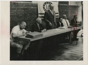 Iron Man magazine founder Peary Rader, speaking at an Amateur Athletic Union (AAU) meeting, from the Peary and Mabel Rader Collection.
