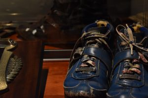 The powerlifting shoes belonging to Stark Center co-founder Jan Todd, in a display case, in the Strong Men, Strong Women Gallery