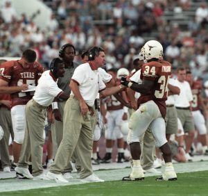 Former University of Texas football coach Mack Brown, with former Texas football player Ricky Williams, at a home game against Rice, from the Mack Brown Collection.
