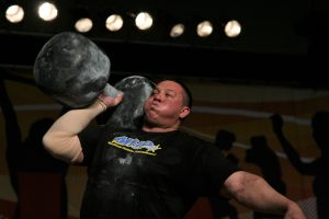Strongman Mikail Koklyaev while pushing the 195 pound circus dumbbell overhead six times, at the Arnold (Schwarzenegger) Strongman Classic in 2006, in Columbus, Ohio