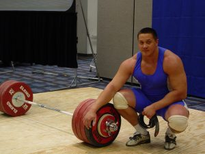 Strongman Mikail Koklyaev after having cleaned and jerked a 529 barbell overhead with two hands, at the Arnold (Schwarzenegger) Strongman Classic in Columbus, Ohio