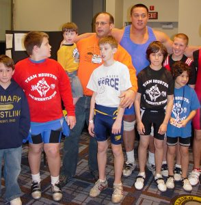 Arnold (Schwarzenegger) Strongman Classic Co-Director Steve Slater, Slater's sons Landon and Phillip, strongman Mikail Kolkyaev and several young weightlifters