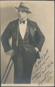 Bodybuilder Siegmund Klein in formal attire, in a photogrpah dedicated to wrestler and strongman George F. Jowett, from the scrapbooks in the George F. Jowett Collection