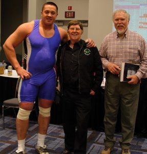 Terry Todd,Stark Center co-founder,  David P. Webster, and strongman Mikail Koklyaev after Koklyaev cleaned and jerked a 529-pound barbell at the Arnold (Schwarzenegger) Strongman Classic, in Columbus, Ohio