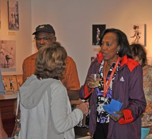 Madeline Manning Mims mingling in Stark Center exhibit area.
