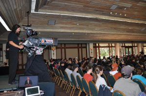 The Longhorn Network was on site for the event. View of the camera man in the back of the ballroom filming the event.