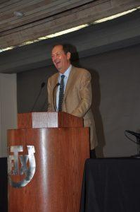 Senator Bill Bradley at podium addressing the audience