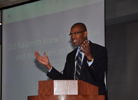 Dr. Reuben A. Buford May at podium giving his presenation