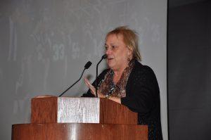 Professor Madeleine Blais speaking at podium