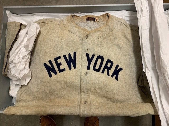 Photo of a New York Yankees Jersey folded inside of an archival box