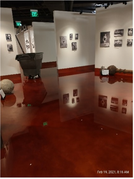 """These shots were all taken on Friday morning, when we still had water standing in many places in the Stark Center. The left shot is in the """"strongman/strongwoman"""" gallery. The cart is catching the leak."""